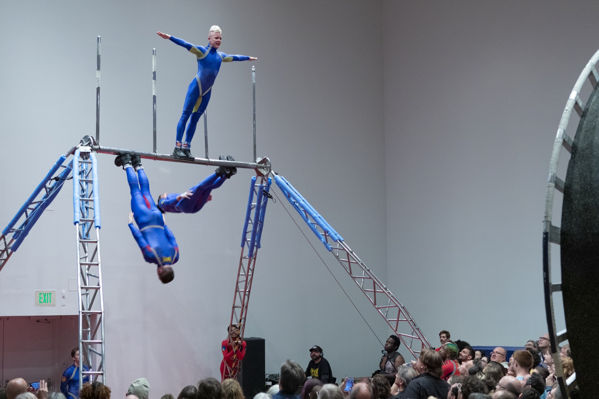3 bodies rotate around a horizontal pole by their feet
